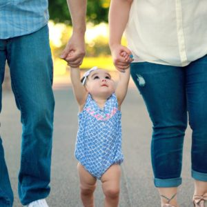 training Attachment Based Practice with Families - parents walking with toddler