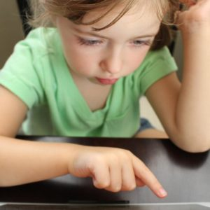 training Communicating with Children - child pointing at computer screen